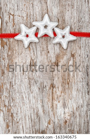 Christmas decoration with red ribbon and silver stars - stock photo