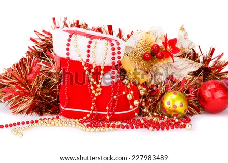 Christmas decoration with Santa's red boot, garland, balls, beads isolated on white background. - stock photo
