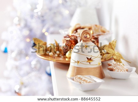 Christmas decoration with the bell and Christmas tree in background - stock photo