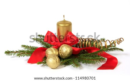 Christmas decoration with the golden nuts, twigs of the spruce and candle - stock photo
