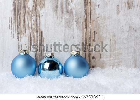 Christmas decoration with wood background, snow and christmas balls turquoise - stock photo