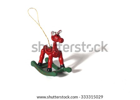 Christmas decoration, wooden horse isolated on white background.