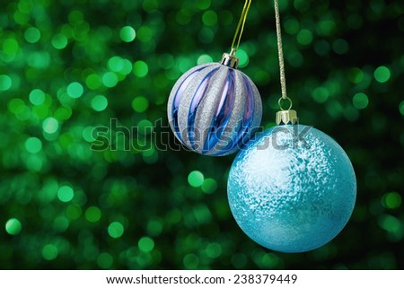Christmas decorations against green abstract background - stock photo