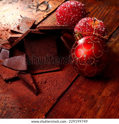 Christmas decorations and chocolate - stock photo