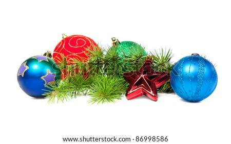 Christmas decorations and fir branch isolated on white background - stock photo