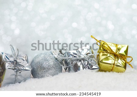 Christmas decorations and gift on snowflake and bokeh lights background  - stock photo