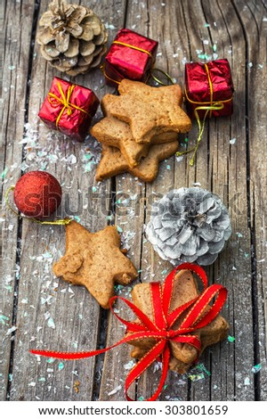 Christmas decorations and gingerbread cookies on wooden table .Photo tinted. - stock photo