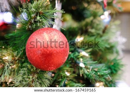 Christmas decorations and lights hanging on a Christmas tree - stock photo
