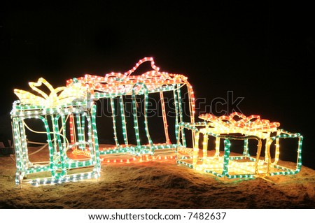 Christmas decorations and lights in present shape - stock photo