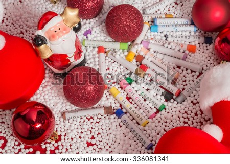 Christmas decorations and oil crayons - stock photo