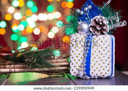 christmas decorations and presents with background lights  - stock photo
