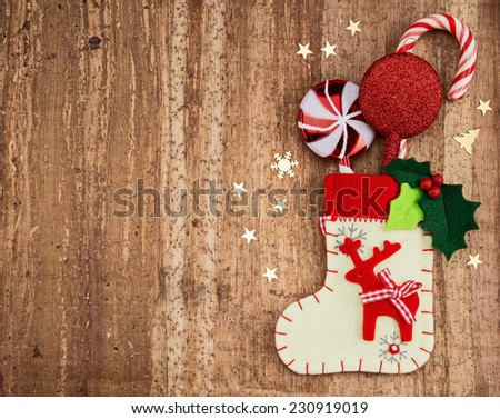 Christmas decorations and sock on wood background. Beautiful Christmas card. - stock photo