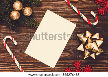 Christmas Decorations And White Card On The Table/ Christmas Background - stock photo