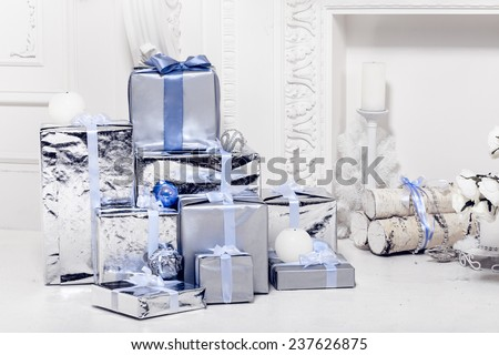 Christmas decorations and white fireplace. Sudio shot - stock photo