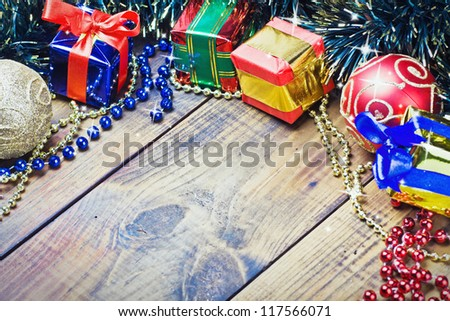 Christmas decorations, balloons and gifts on the table - stock photo