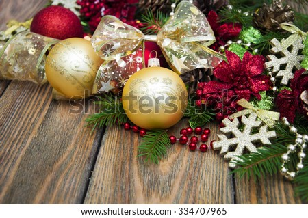 Christmas decorations,baubles,ribbon on a wooden background - stock photo