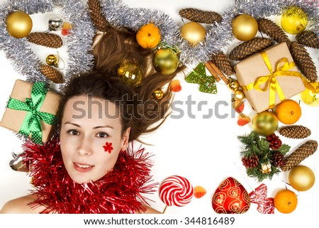 Christmas decorations. Beautiful model on white. cones, gifts and sweets. candy, tinsel. portrait - stock photo