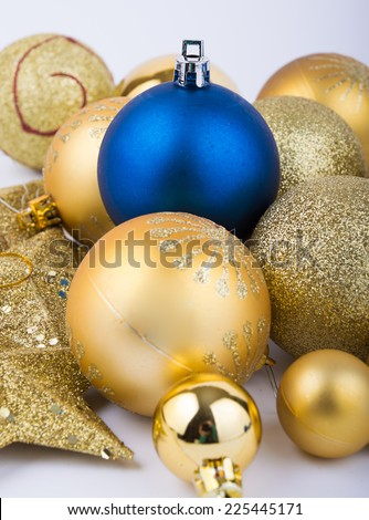 Christmas decorations blue and gold balls and gold stars