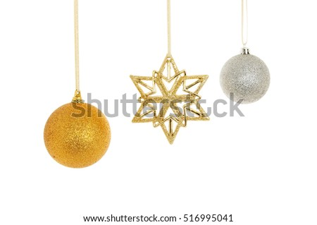 Christmas decorations, gold glitter star and silver and gold glitter baubles isolated against white