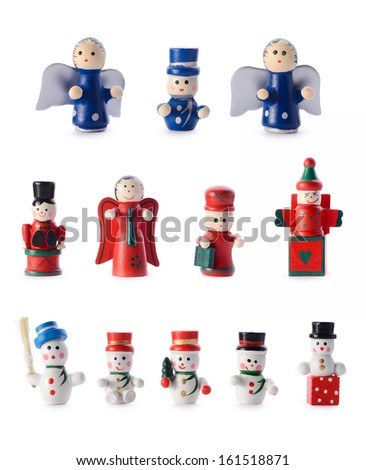 Christmas decorations: group of small retro-styled figurines, christmas tree decorations, isolated on white background - stock photo