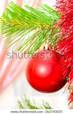 Christmas decorations hanging on a pine tree with glitter, sparkle, scintillation - stock photo