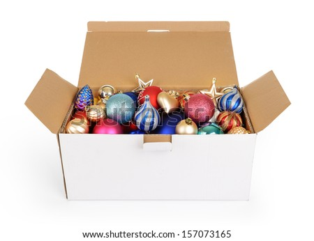 Christmas decorations in a white cardboard box on white background. File contains a path to isolation. - stock photo