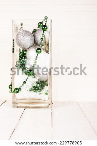 Christmas decorations in glass vase - stock photo