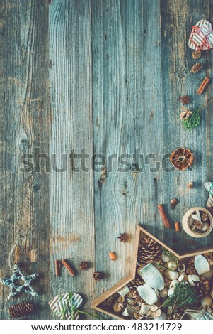 christmas decorations in star shaped box on old wooden background with text space top view