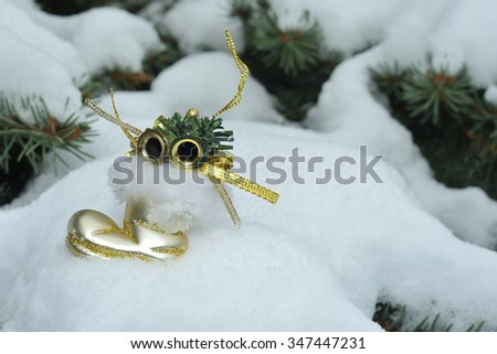 Christmas decorations in the snow - stock photo