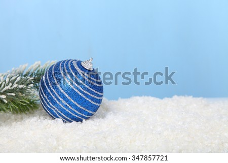 Christmas decorations in the snow on a blue background