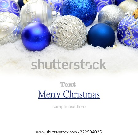 Christmas decorations in the snow on a white background