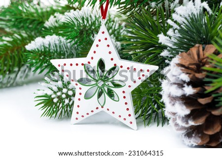Christmas decorations on a background of fir branches, close-up - stock photo