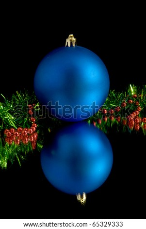 christmas decorations on a black background - stock photo