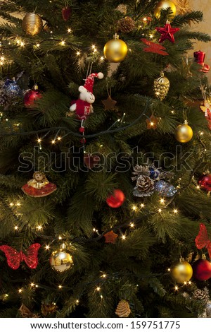 Christmas decorations on a Christmas tree - stock photo