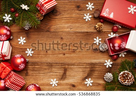 Christmas decorations on a rustic wood background, vintage retro style