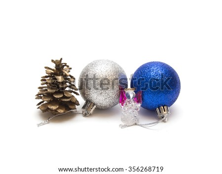 Christmas decorations on a white background. Christmas balls, cone of a coniferous tree, glass figure of the angel