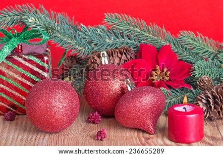 Christmas decorations on a wood floor with red background - stock photo