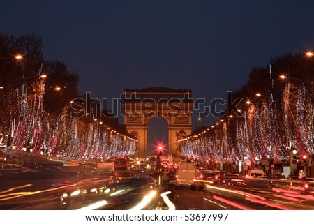 Christmas decorations on Champs Ã?lyses - blurred motion cars, copy space on sky. - stock photo