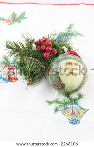 Christmas decorations on festive fabric
