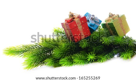 Christmas decorations on fir tree, isolated on white - stock photo