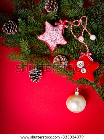 Christmas decorations on hot red background. Christmas and 2016 New Year theme. Place for your text, wishes, logo. Mock up. Vignetted. - stock photo