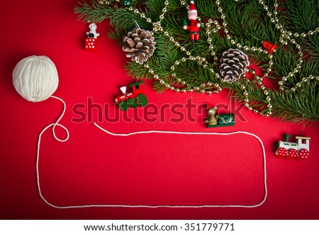 Christmas decorations on hot red background. Christmas and New Year theme. Place for your text, wishes, logo. Mock up. Vignetted. - stock photo