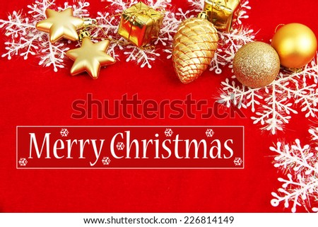 Christmas decorations on red fabric background - stock photo