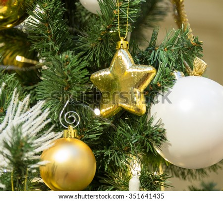 Christmas decorations on the branches fir. - stock photo