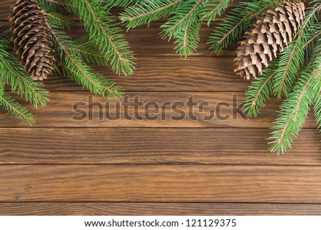 Christmas decorations on wooden background - stock photo