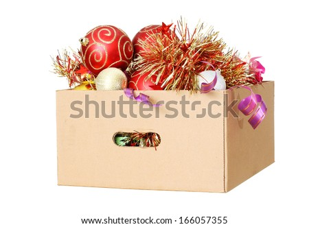 Christmas Decorations packed away in a cardboard box - stock photo