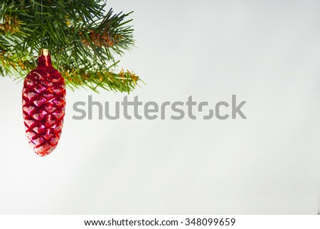 Christmas decorations red glass pine cone spruce on Christmas tree background - stock photo
