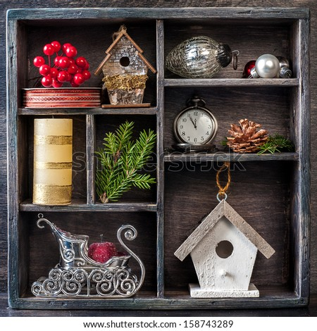 Christmas decorations set: antique clocks, birdhouse, Santa's sleigh and Christmas toys in a vintage wooden box - stock photo