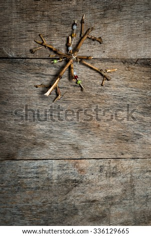 Christmas decorations snowflake on wooden background - stock photo