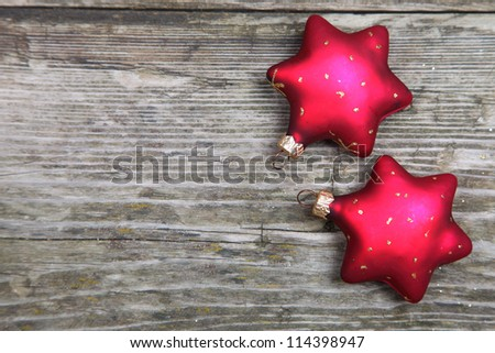 Christmas decorations. Two red stars on a wooden background